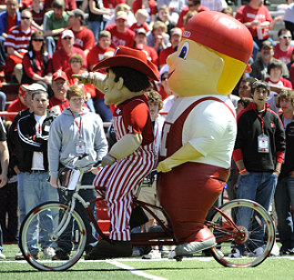 Nice shot of the two current mascots enjoying a bicycle ride on the sidelines of the 2008 Red-White game.  Go Huskers!